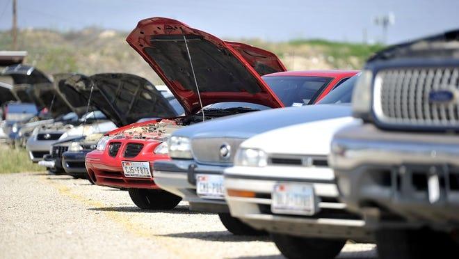 REPORTER-NEWS FILE PHOTO - Abilene police vehicle impound auction.