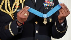 A military aide holds up the nation's highest military