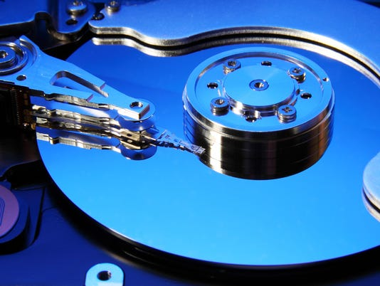 Close-up view of the opened hard disk drive
