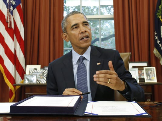 Obama signs two-year budget deal
