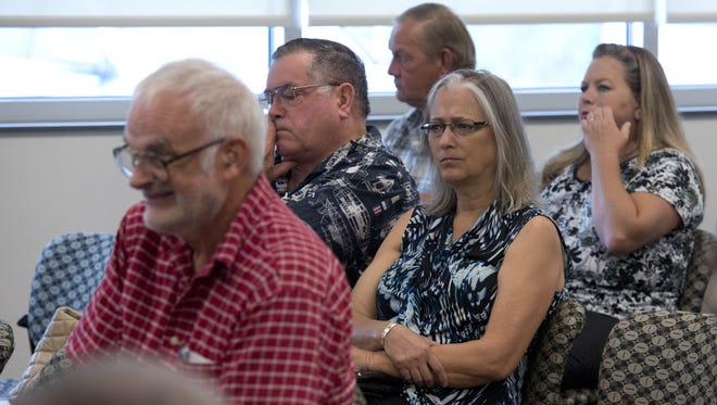 Escambia County residents attend a meeting of the Escambia County Planning Board to voice thier  concerns over two new developments one in the Cantonment area and another in the Beulah area Tuesday morning.