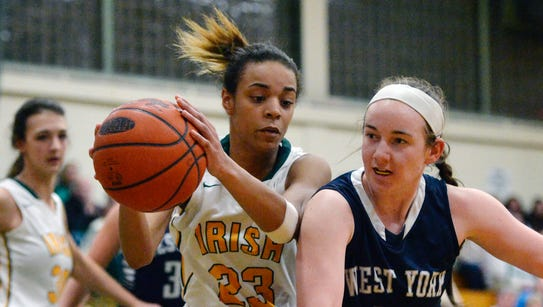 York Catholic's Jania Wright gets the rebound against