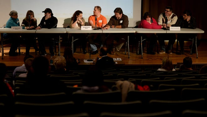 Teams work together to answer trivia questions during the 2015 Rotary Club Quiz Bowl at Indiana University East in Richmond.