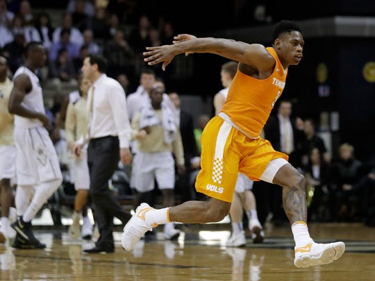Tennessee forward Admiral Schofield runs across the court as he celebrates after a play against Vanderbilt during the second half of an NCAA college basketball game Tuesday, Jan. 9, 2018, in Nashville, Tenn. Tennessee won 92-84. (AP Photo/Mark Humphrey)