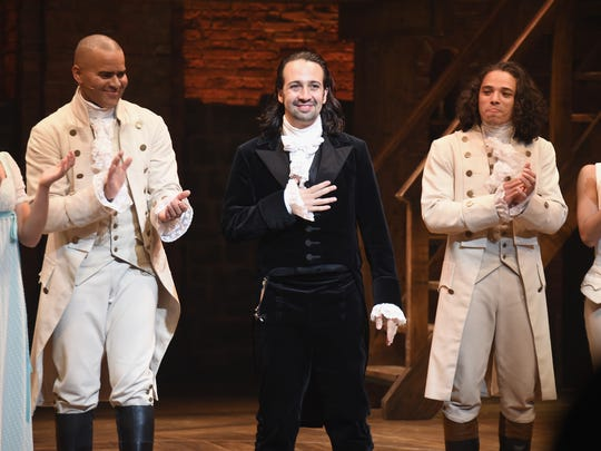 "Lin-Manuel Miranda (center) wrote his musical ""Hamilton"" after being inspired by Ron Chernow's biography. Chernow will be at Purdue University on Tuesday evening."