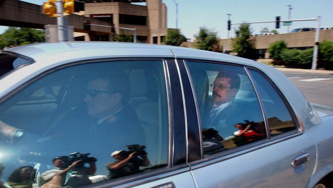 May 26, 2005 - State Senator John Ford, right, arrives from Nashville after being arrested as part of the Tennessee Waltz operation.