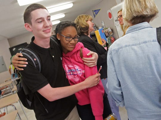 David Grenier (left), 16, gives classmate Aria Badson, 16, a hug while leaving class after Badson shared an emotional story of a relative's struggle with drug addiction during a drug prevention presentation in their health class May 23 at Alexis I. du Pont High School.