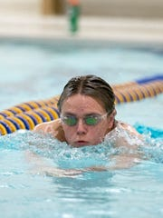 Drew Ellery swims laps in Delta's Pool Tuesday afternoon during a swim practice before sectional prelims.