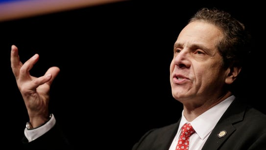 New York Governor Andrew Cuomo delivers one of his