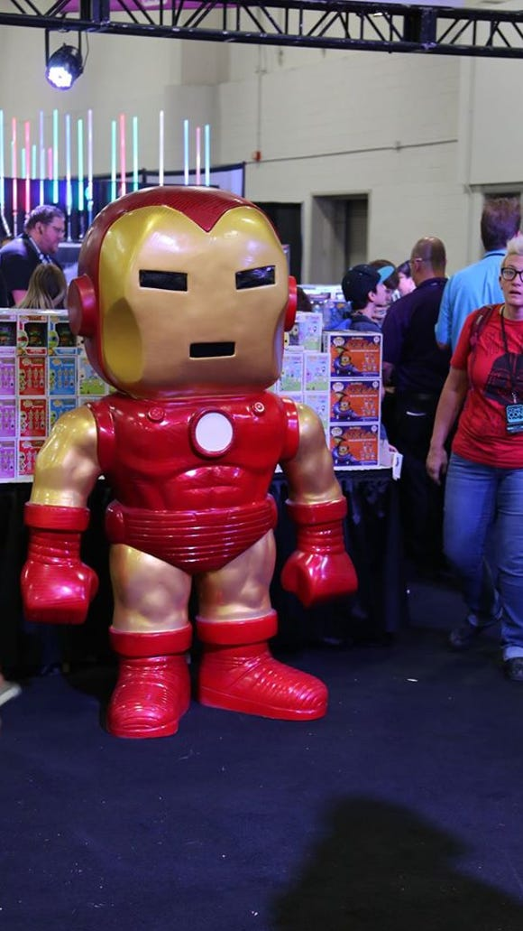 A giant figure of Iron Man stands at the Pop Life booth at Salt Lake Comic Con on Sept. 24, 2015.