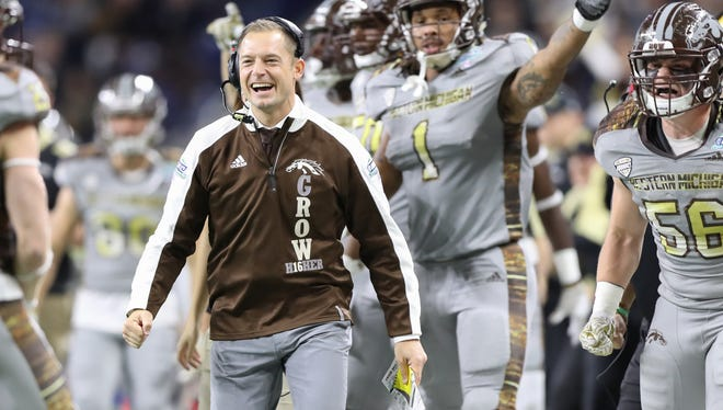 Coach P.J. Fleck and the Western Michigan sideline celebrate a first-half fumble recovery in the Mid-American Conference championship game at Ford Field on Dec. 2.