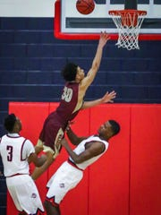 Riverdale's Johnathan Matthews goes up as Oakland's Tre Jones defends Friday.