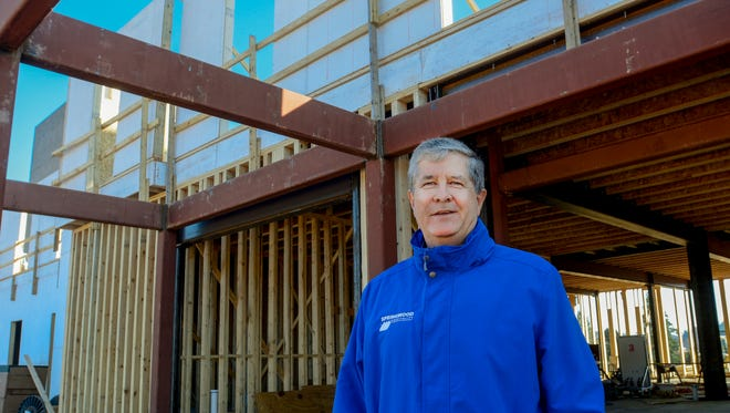 Dave Hogg, CEO of Springwood Hospitality, pictured in front of the construction site for his Home2Suites by Hilton hotel, which opened recently in York