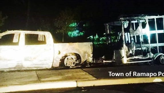 This photo shows the damage to a truck and trailer that caught fire in a Provident Bank Park parking lot. Police are investigating.