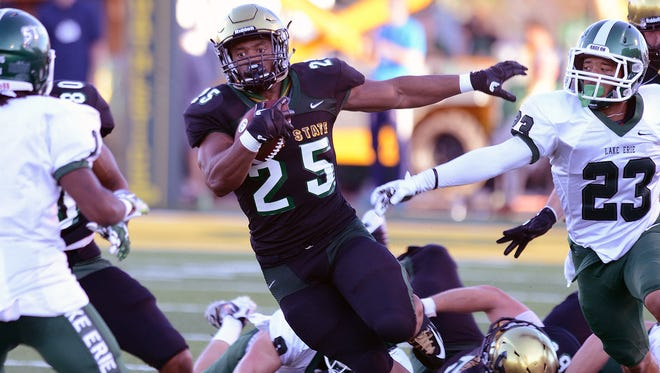 Wayne State's Romello Brown carries the ball during the win over Lake Erie Saturday in Detroit.