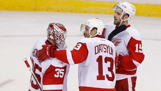 Detroit Red Wings center Pavel Datsyuk (13) celebrates with Detroit Red Wings goalie Jimmy Howard (35) after their game against the Washington Capitals at Verizon Center.