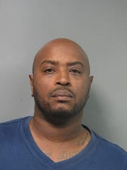 Akil Garrett, 41, was arrested Friday on drug charges in Dover.
