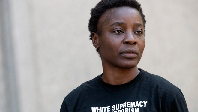 "Therese Okoumou leaves Federal court, Thursday, July 5, 2018, in New York. Okoumou, who climbed the base of the Statue of Liberty on a busy Fourth of July in what prosecutors called a ""dangerous stunt"" pleaded not guilty Thursday to misdemeanor trespassing and disorderly conduct . A federal judge released  Okoumou without bail after her court appearance.  (AP Photo/Mary Altaffer)"