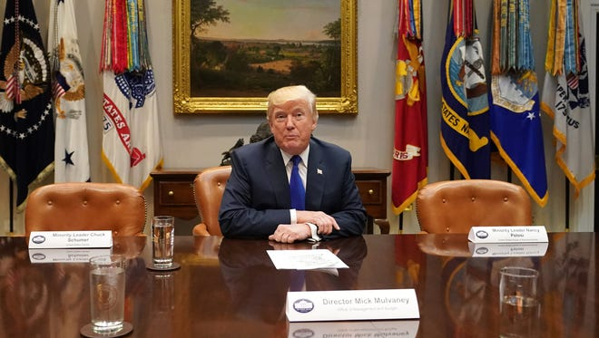 President Trump speaks to the media during a meeting with congressional leadership in the Roosevelt Room at the White House, in Washington, D.C. Trump sat beside empty chairs which would have held House Minority Leader Nancy Pelosi and Senate Minority Leader Chuck Schumer who pulled out of the huddle.