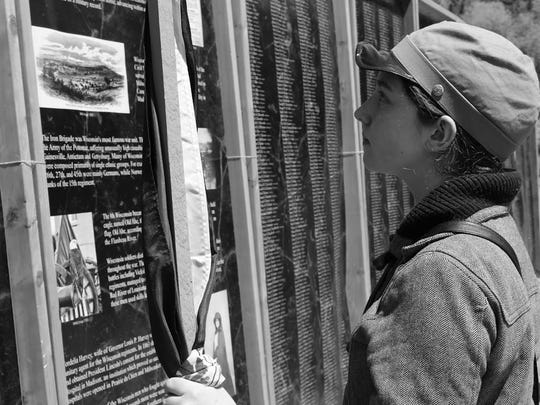 A student views the D.C. Everest Civil War Wall.