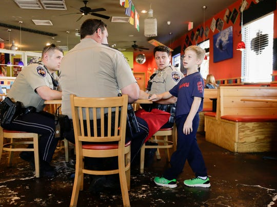 Oliver Perry talks with Lafayette Parish deputies during