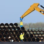 Pipes for the proposed Dakota Access oil pipeline, that would stretch from the Bakken oil fields in North Dakota to Patoka, Ill., are stacked Saturday, May 9, 2015, at a staging area in Worthing, S.D. The proposed oil pipeline will traverse North and South Dakota, Iowa and Illinois.