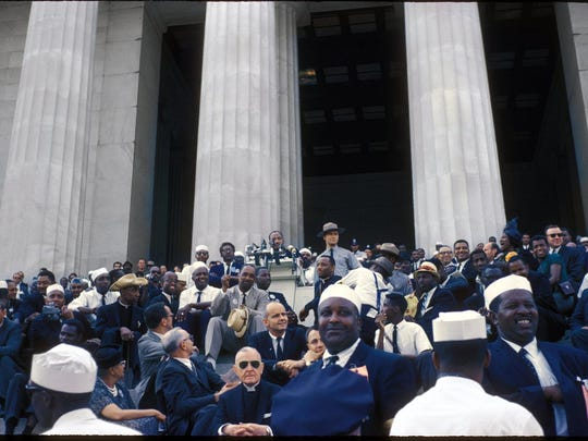 """Martin Luther King delivers his famous """"I have a dream"""" speech, August 28, 1963, on the steps of the Lincoln Memorial in Washington, D.C. Other notables in the photo include Sen. William Proxmire (directly below MLK on steps); Bayard Rustin, with glasses, to the right of King; in crowd in right half of image, Sammy Davis Jr., Whitney Young, and Mahalia Jackson. (William J. Scott Jr./TNS)"""