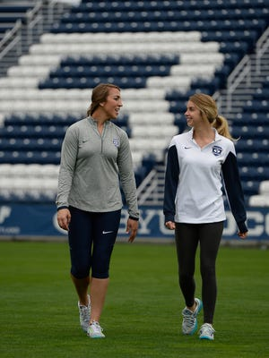 BYU goalie Rachel Boaz, left, and midfielder Paige Hunt pose for a photo in Provo, Utah. Female college athletes like Rachel and Paige interrupted their college careers and went on LDS Church missions when the church changed the minimum age to 19. Many of these athletes are now returning to courts, fields and arenas, and having a big impact on college sports in the state.