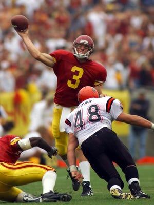 Southern California quarterback Carson Palmer throws a pass against San Diego State during their game in 1999.