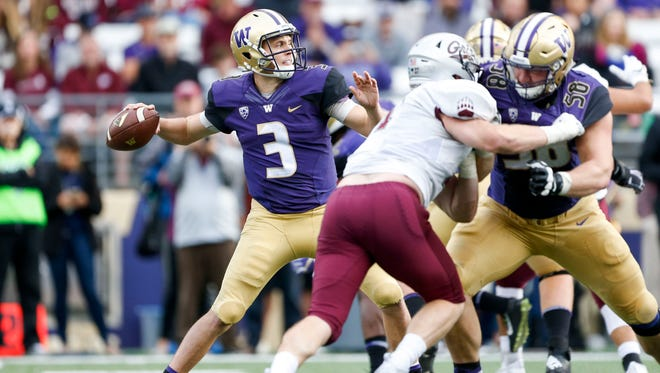 Washington Huskies quarterback Jake Browning (3) passes against the Montana Grizzlies during the second quarter of Saturday's game.