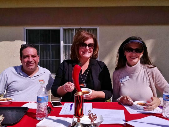 Chili cook-off judges Dave Acosta, Katie Stice and
