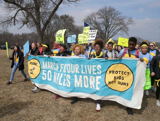 Students finish a four-day, 50-mile march to  the hometown