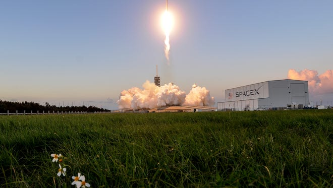 A SpaceX Falcon 9 rocket lifts off from pad 39A at Kennedy Space Center on Oct. 11. The rocket carried the Echostar 105/SES-11 telecommunications satellite.