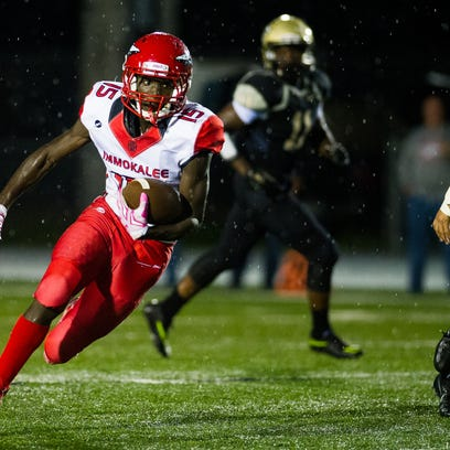 Immokalee High School's Yanavis Fuller (15) takes the