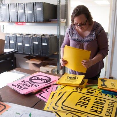 Jennifer Smith-Zande gets signs ready for the Nov.
