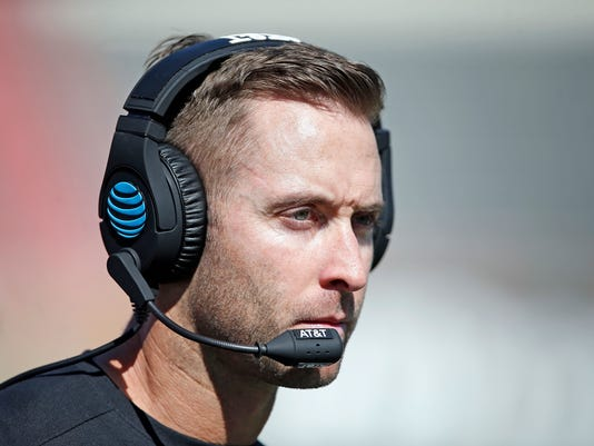 FILE - In this Oct. 21, 2017 file photo, Texas Tech coach Kliff Kingsbury walks down the sidelines during an NCAA college football in Lubbock, Texas. Since winning their first seven games after former quarterback Kingsbury became their coach in 2013, the Red Raiders are 22-31 and missed out on bowl games two of the past three seasons. (Brad Tollefson/Lubbock Avalanche-Journal via AP, File)