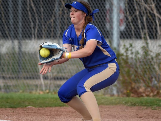 Reed's Jilian Kygar gets the out at first base during