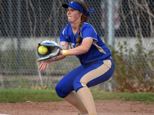 Reed's Jilian Kygar gets the out at first base during Thursday's game against Wooster.