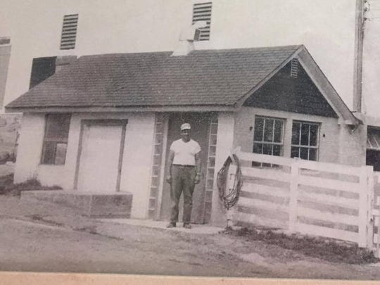 A large barn in the 2400 block of Back Road was destroyed during a fire in the early morning hours of June 25. The family provided this historical photo of Bruce Gamble with the barn. The barn was a part of Bruce D. Gamble and Sons Feed and Supply.