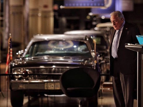 Ex-Secret Service agent Clint Hill speaks Tuesday, Nov. 19, 2013, at the Henry Ford Museum in Dearborn, Mich., near the car that President John F. Kennedy was shot in. Hill stood for his presentation and never turned to look at it.