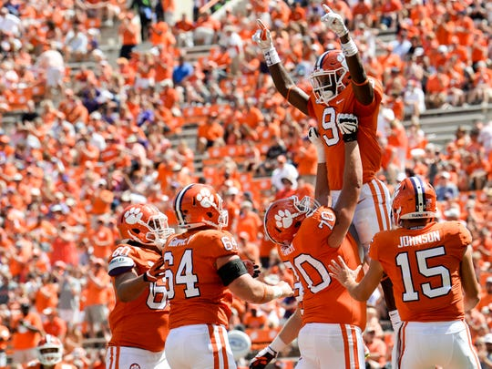 Clemson teammates celebrate after running back Travis Etienne (9) scores a touchdown against Kent State during the fourth quarter in Memorial Stadium at Clemson on Saturday.