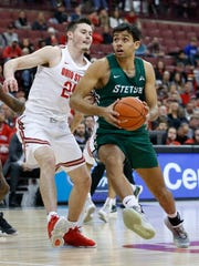 Stetson's Cyriaque Foucart, right, drives to the basket as Ohio State's Kyle Young defends during the first half of an NCAA college basketball game Monday, Nov. 18, 2019, in Columbus, Ohio. (AP Photo/Jay LaPrete)