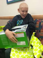 Carson, 12, received an Xbox and games from Little Wish. He is a patient at Peyton Manning Children's Hospital.