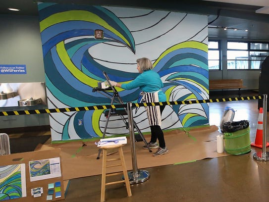 Cynthia Lait wanted to brighten up the walls of Bainbridge's ferry terminal with a mural, and she raised money to pay for it through a Kickstarter campaign.