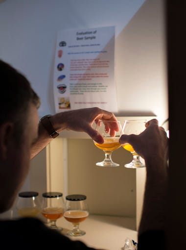 Off-centered storyteller Justin Williams samples batches of various beer as part of a sensory testing exercise Wednesday, Feb. 11 at Dogfish Head in Milton.