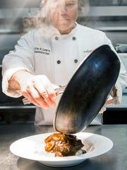 The Hobbit's executive chef Jim B. Lewis prepares a