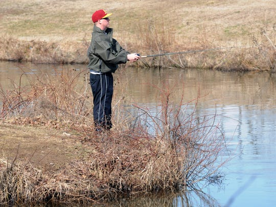 Jeremy Drago, former president of Dover Bass Club,  fishing at Wyoming Lake spillway off Wyoming Mill Road.