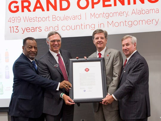 "Montgomery County Commission Chairman Elton N. Dean Sr., far left, and Montgomery Mayor Todd Strange, far right, present a city-county proclamation naming May 10 ""Coca-Cola Day."" John H. Sherman, center, left, chief executive office, Coca-Cola Bottling Company United, and Claude B. Nielsen, center, right, chairman of the board, Coca-Cola Bottling Company United, accept the proclamation."