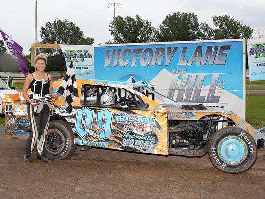 """Kelsy-Ann Hayes in Victory lane at Thunderhill Raceway in Sturgeon Bay after a win. Hayes is among the local racers featured in the new book by Joe Verdegan, """"Life in the Past Lane: The Next Generation."""""""