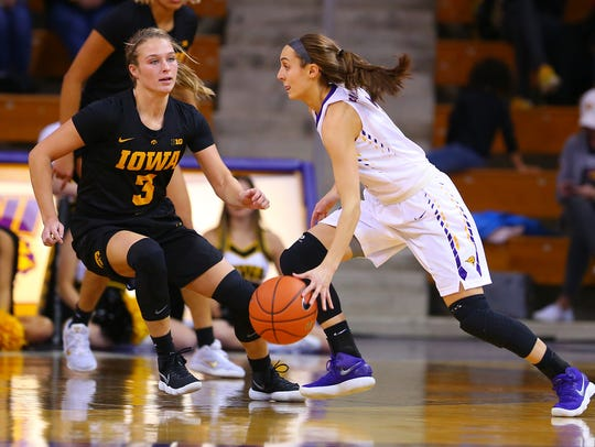 UNI's Karli Rucker looks to drive against Iowa's Makenzie